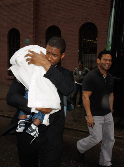 Usher brings family to work.